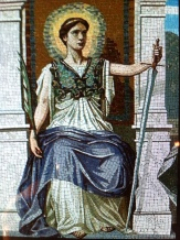 """THE LAW PERSONALIZED Mosaic representing both the judicial and legislative aspects of law. The woman on the throne holds a sword to chastise the guilty and a palm branch to reward the meritorious. Glory surrounds her head, and the aegis of Minerva signifies the armor of righteousness and wisdom. Frederick Dielman (1847-1935) Search Wikipedia """"The rule of law"""". Search Google images """"The rule of law"""". designed this mosaic representing Law for the United States Library of Congress, and it was subsequently manufactured in Venice, Italy.[1] A young woman on a marble throne holds a sword in one hand to chastise the guilty and a palm branch in the other hand to reward the meritorious. A glory surrounds her head, and on her breast is the aegis of Minerva, signifying she is clad in the armor of righteousness and wisdom. Other portions of this large mosaic are omitted from this image. This mosaic indicates not only the judicial but the legislative side of law; typical symbols of justice are less conspicuous or omitted, and the woman has a freer air of command.[2]"""